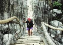 A precarious bridge over a glacier-fed river
