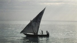 A traditional dhow sails by Chumbe Island