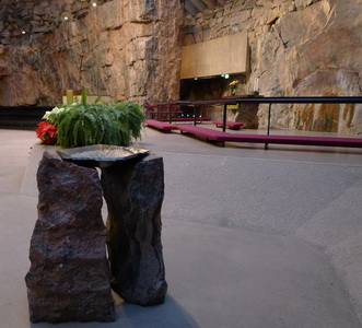 Inside Helsinki's Church in the Rock with its rough-hewn native rock walls