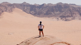 Taking in the view after scrambling to the top of the Mountain in Wadi Rum (Photo by Rachael Cerrotti)