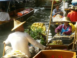 Buying and selling at a Thai  floating market