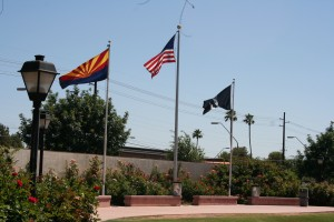 Flags Fly at the Memorial Garden Among Roses (photo credit: Chuck Eirschele)