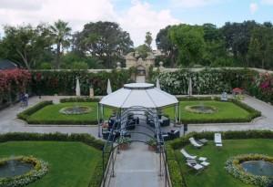 A garden of Italian symmetry greets visitors.