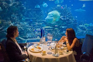 Diners Enjoying An Evening At Al Mahara Restaurant In Burj Arab Hotel Dubai Uae Seafood Accessible By A Three Minute Virtual Submarine