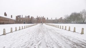 Snowy road and in the distance a red palace with many chimneys