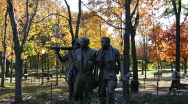 The Three Soldiers Bronze Set in a Landscape Under a Canopy of Trees (photo credit: Chuck Eirschele, c 2008)