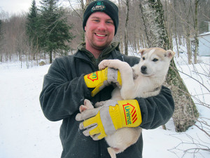 Joe and a sled dog puppy