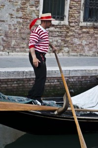 Italy, Venice, gondolier w/ red striped shirt