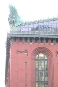 Postmodern details: an owl for wisdom at the corner of the pediment. The Harold Washington Library Center.
