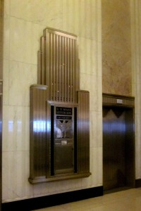 Art deco embellishment in the shape of the Field Building functions as a postal box and elevator indicator in the main lobby...