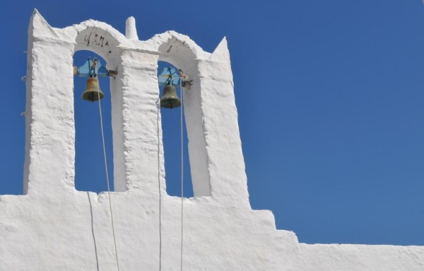 The theme of blinding white, saturated blue, and religions runs through the Greek Islands. The lime based whitewash has antibacterial properties; the white color helps reflect the heat and keep the houses cool.