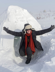 One of our friends emerges from an igloo built to see the old techniques of the Inuit people. Photo by Yvette Cardozo