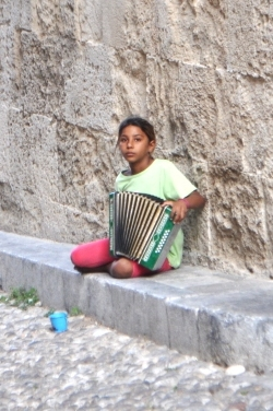 Gyspy girl busking on Rhodes