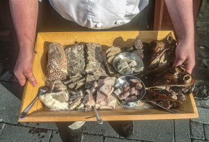 Traditional Icelandic foods on a traditional wood tray. Includes sheephead, pork, liver sausage, leg of lamb, herring and testicles, among other things. Photo by Yvette Cardozo