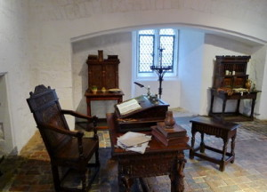 A comfortable, plain room with fine chairs and writing desk