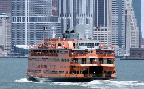 The Staten Island Ferry with Manhattan skyline behind it.