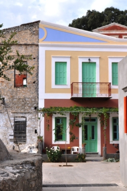 Neighbors on Symi with different home decor aesthetics.