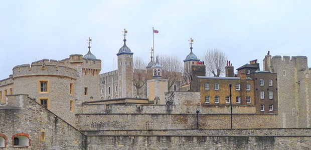 Skyline of the Tower of London showing light coloured walls and many towers