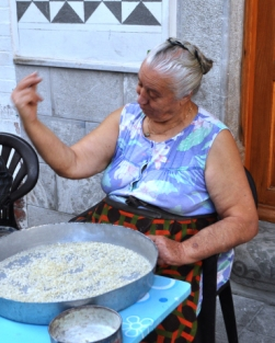 Women explains processing mastic in Chios.