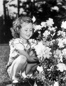 Girl and azalea blossoms