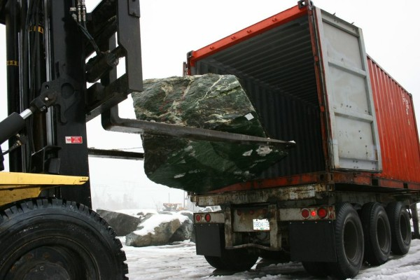 A jade boulder is loaded into a container on a road 100 miles from the mine (Courtesy The Jade Mine)