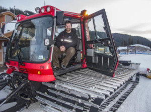 Snow cat driver Scott Thompson with his grooming machine at the base of Sun Peaks Resort, BC, Canada. Photo by Yvette Cardozo