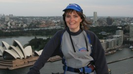 Author Laura Byrne Paquet at the top of the Sydney Harbour Bridge. Photo courtesy of OTTTO Holdings (Aust.) Pty Limited ACN 079 564 346 trading as BridgeClimb Sydney.