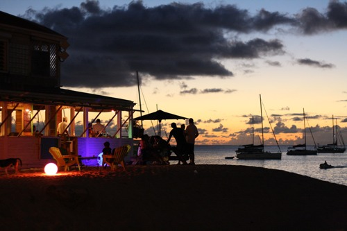Thirsty shoppers head to beachfront patios in Grand Case as the sun sets on Harmony Night (photo by Laura Byrne Paquet c 2011).