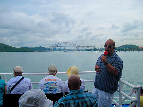 Tour guide explaining the entrance to the Panama Canal