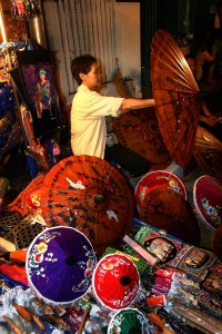 A woman selling paper umbrellas at the Sunday Market in Chiang Mai