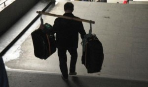 The porter with our cases. (Photo credit Ann Burnett 2013)