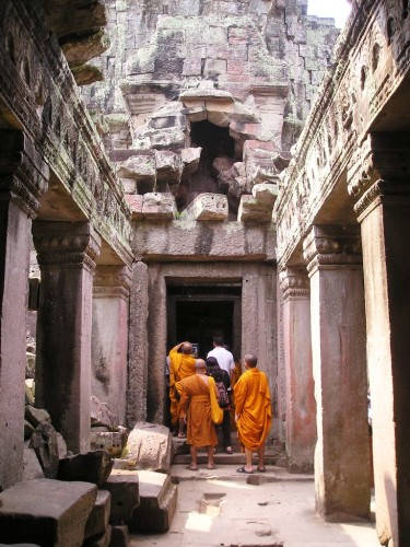 Buddhist monks visiting a temple in the Angkor Archeological Park, Cambodia