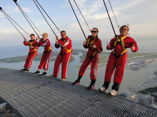 EdgeWalk participants make a fashion statement in red jumpsuits and yellow harnesses (photo courtesy of CN Tower EdgeWalk).