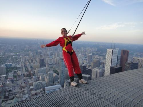 Author Laura Byrne Paquet leans backward high above the Toronto skyline on the CN Tower EdgeWalk (photo courtesy of CN Tower EdgeWalk).