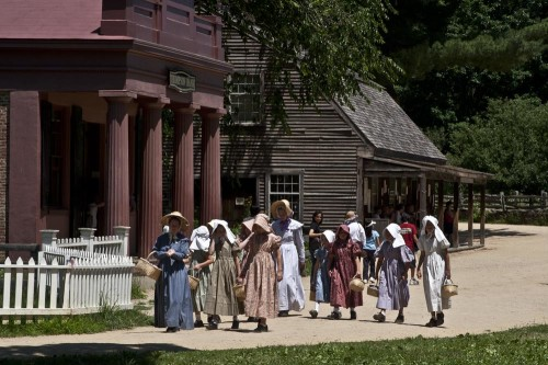 Women and girls passing the bank at Old Sturbridge Village (Photo copyright Stillman Rogers)