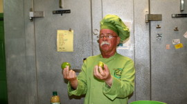 Kermit demonstrates the difference between a key lime (right) and Persian lime.