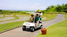 Players and caddies ride on a golf cart at Nirwana Bali (Photo credit: MCArnott)