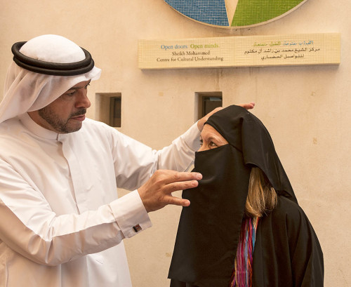My friend Kari tries on abaya (Muslim robe) at the Sheikh Mohammed Centre for Cultural Understanding in Dubai, UAE. The center has guides who talk about Muslim culture, dress and traditional Bedouin life. Photo by Yvette Cardozo
