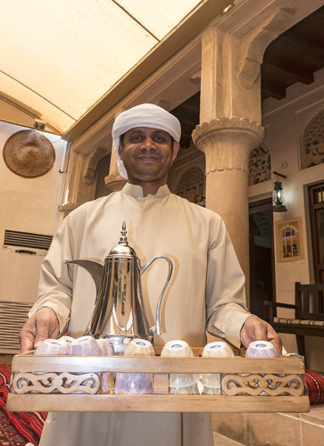 Serving coffee at the Sheikh Mohammed Centre for Cultural Understanding in Dubai, UAE. The center has guides who talk about Muslim culture, dress and traditional Bedouin life. Photo by Yvette Cardozo