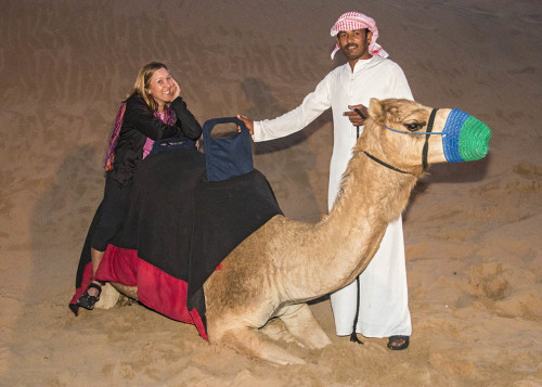 Camel riding at Bedouin camp during desert safari in Dubai, UAE. Photo by Yvette Cardozo