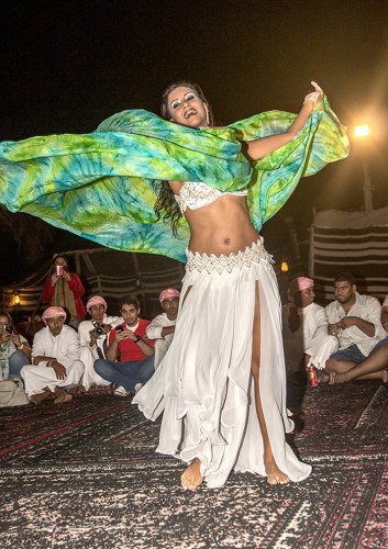 Belly Dancer twirls for guests at Desert Safari outside Dubai. Photo by Yvette Cardozo