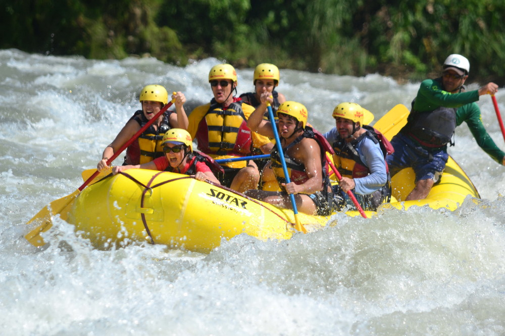 The author rides the bow through class-4 rapids. Credit: Rios Tropicales