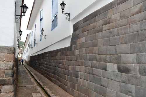 The trapezoidal stone block walls are typical of Inca earth-quake resistant stonemasonry