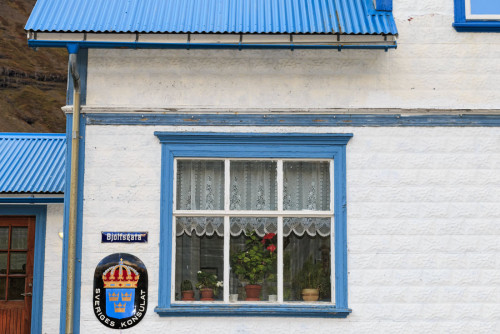Picturesque building in the eastern Iceland town of Seydisfjordur. This is a private residence at Bjólfsgata 8. The sign means that this is the home of the honorary consul of Sweden in Seyðisfjörður. Photo by Yvette Cardozo