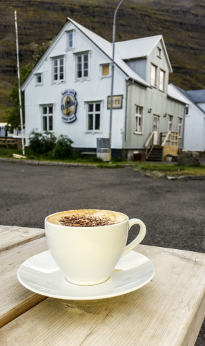Hot cup of cappuccino topped with chocolate flakes in the town of Seydisfjordur in eastern Iceland. Photo by Yvette Cardozo.