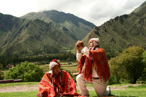 An Inca shaman offers coca leaves to the gods for good crops and energy.