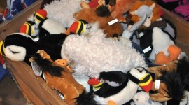 Stuffed puffins and lambs are popular gifts for children.