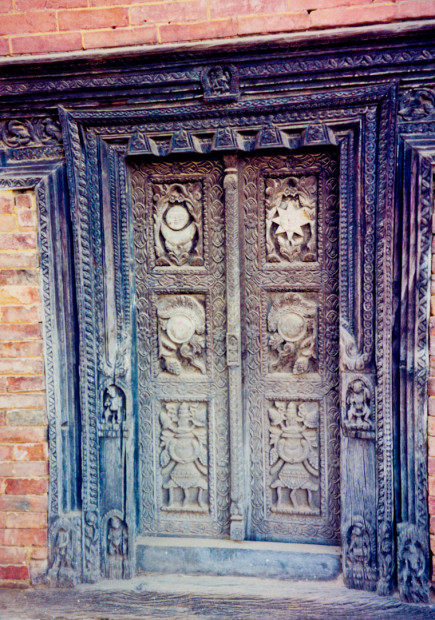 An ornately carved wooden doorway in Bhaktapur