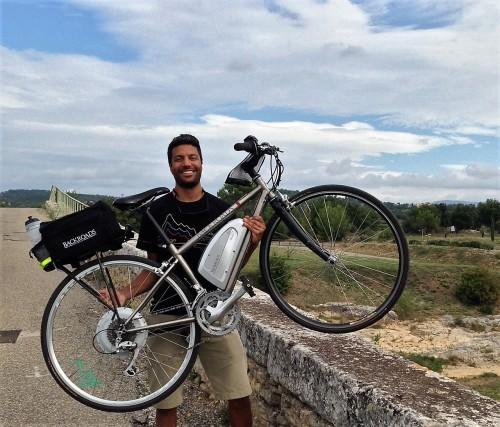 Backroads leader Avi Ragaven hoist e-bike